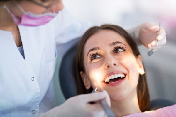 Dentist and patient in dentist office surrey