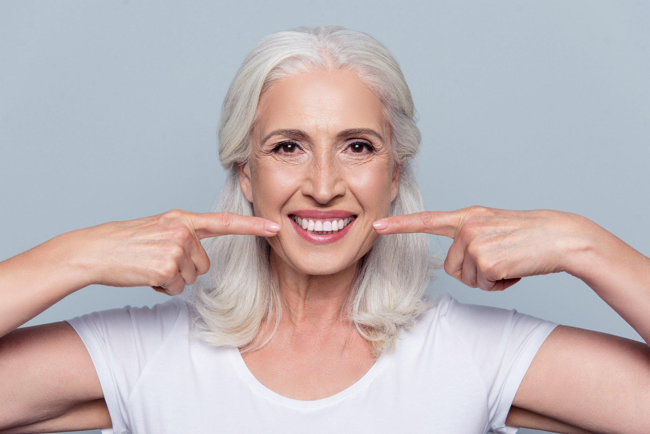 Concept of having strong healthy straight white teeth at old age.